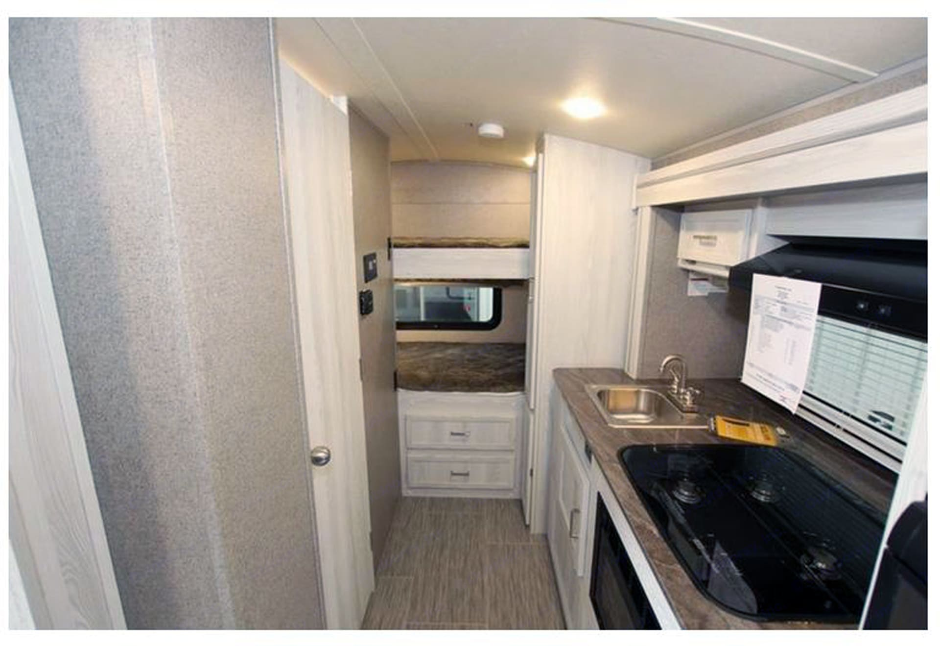 Rear view showing bunks and slide-out kitchen area. Flagstaff E-Pro E16BH 2018