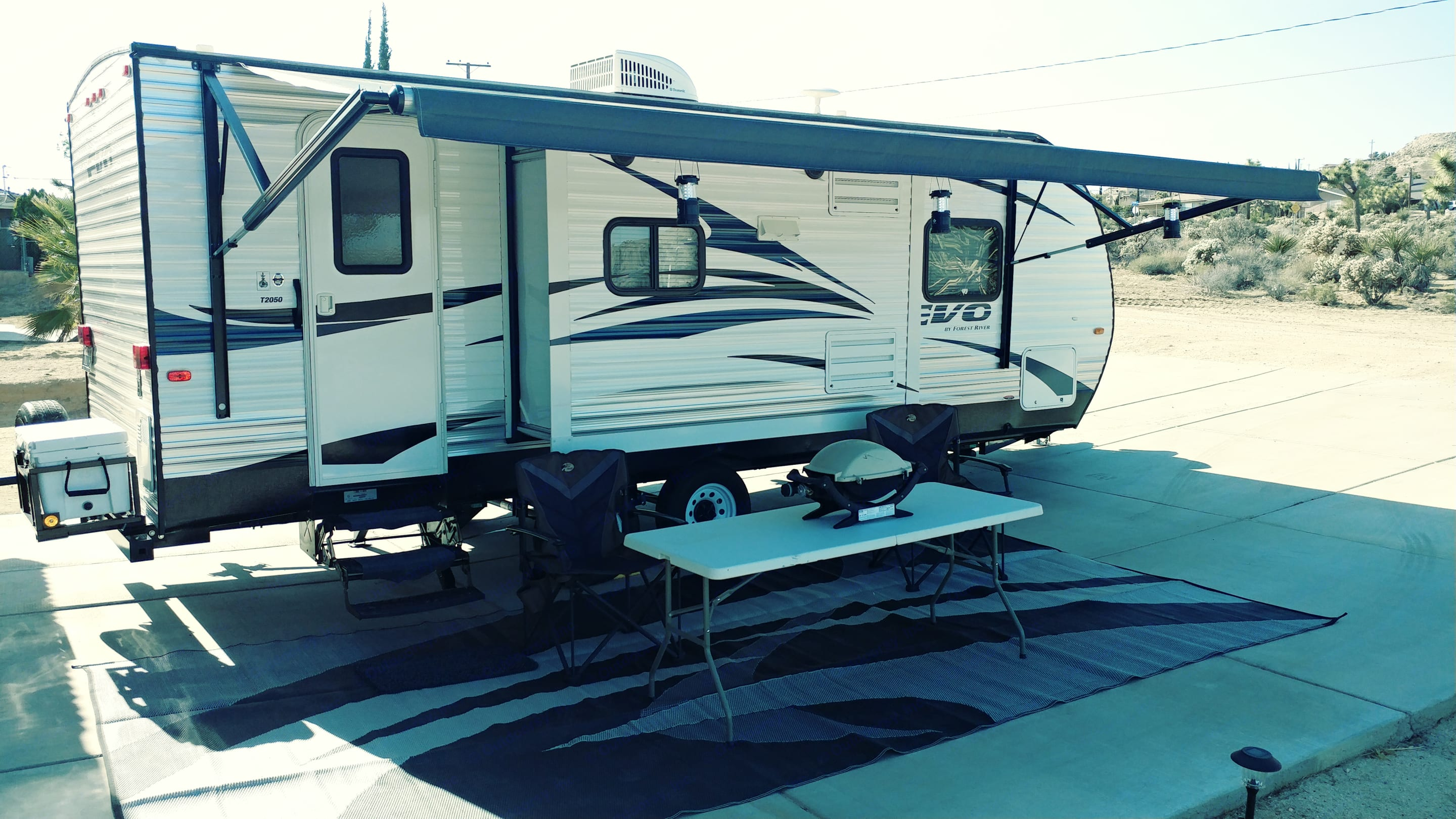 Passenger side electric awning, pop out, and stabilizer jacks. Forest River Evo 2016