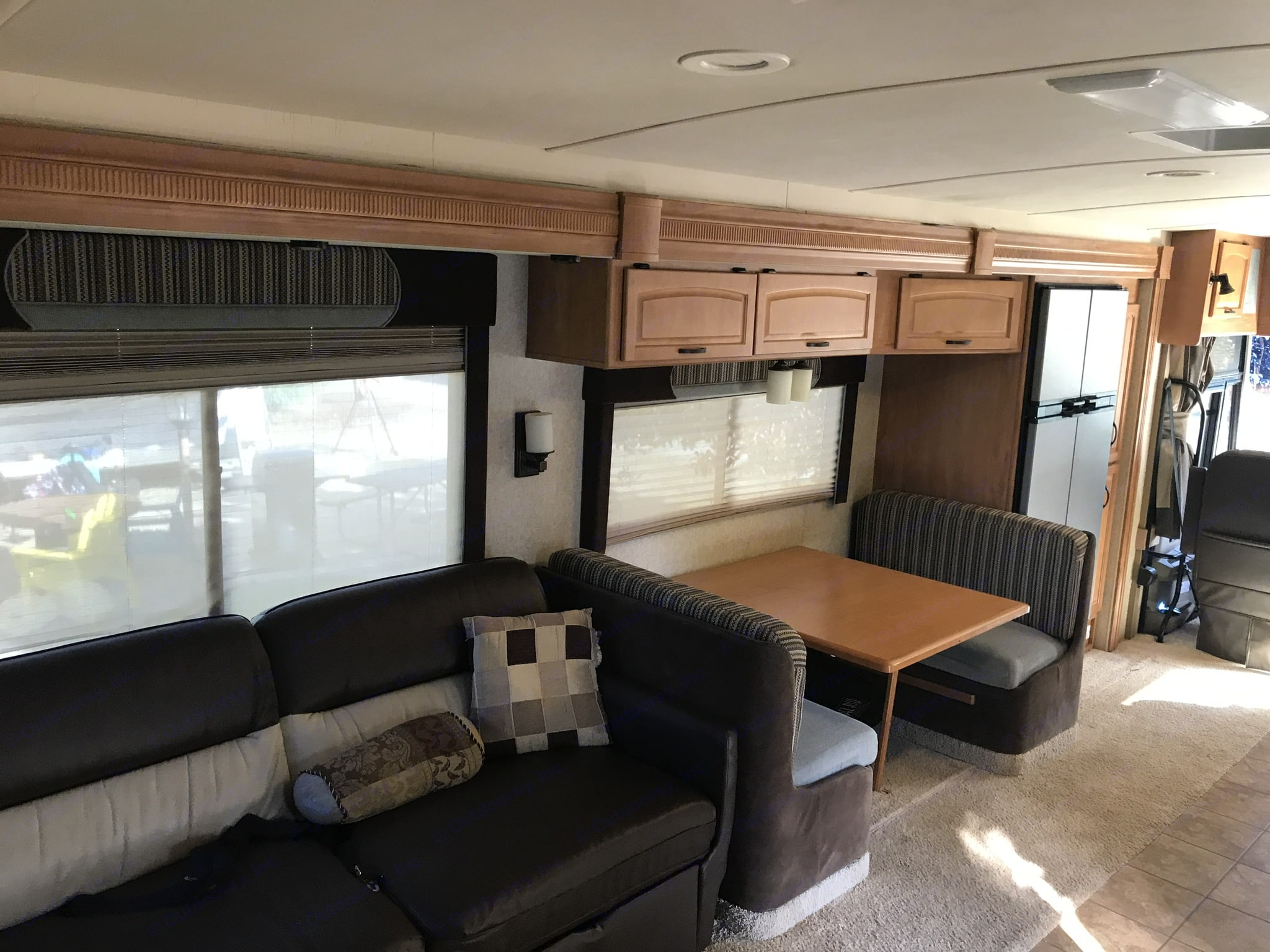 The living space. Large sofa seats 3-4 with slide out ottomans. The sofa converts to a king sized bed. Also includes a recliner. The main slide out opens up the entire living space and galley. The living space opens up on both slides from both slide outs.. Winnebago Adventurer 2008