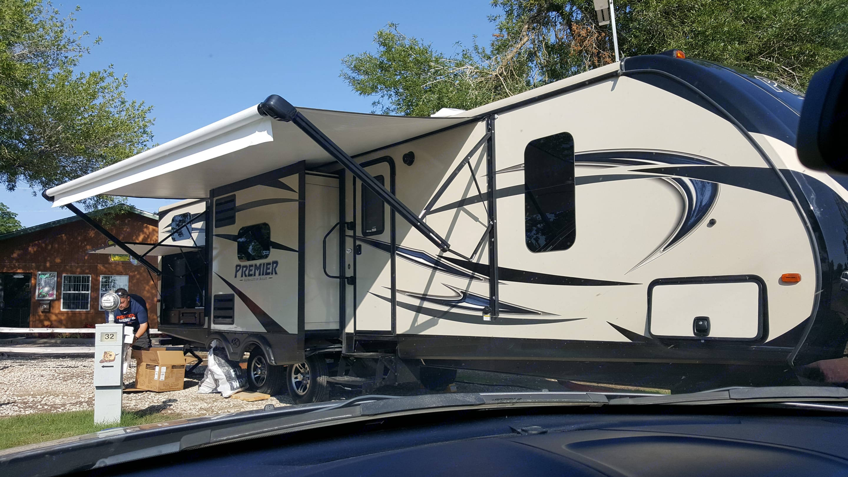 17 ft electric awning, kitchen slide and outdoor kitchen.  Storage at front of travel trailer.. Keystone Bullet Premier 2016