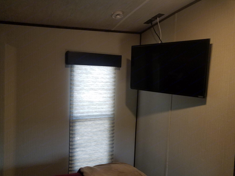 Flat screen smart TV in Master bedroom. Heartland Torque 2018