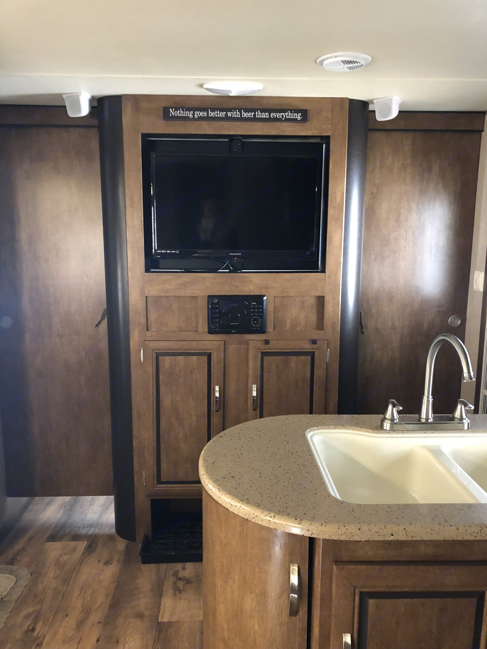 Entry and entertainment center. Picture shown with doors to the master suite closed. . Forest River Wildwood 2017
