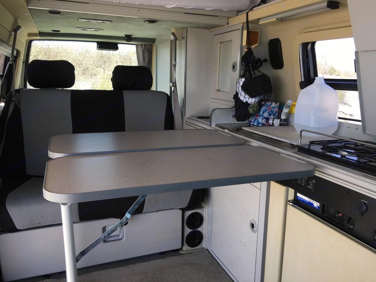 Interior features two simple-to-deploy, adjustable tables. . Winnebago Eurovan Camper Eurovan Camper 2003