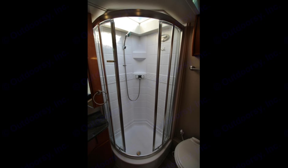 Shower with a skylight. Leisure Travel Unity 2014