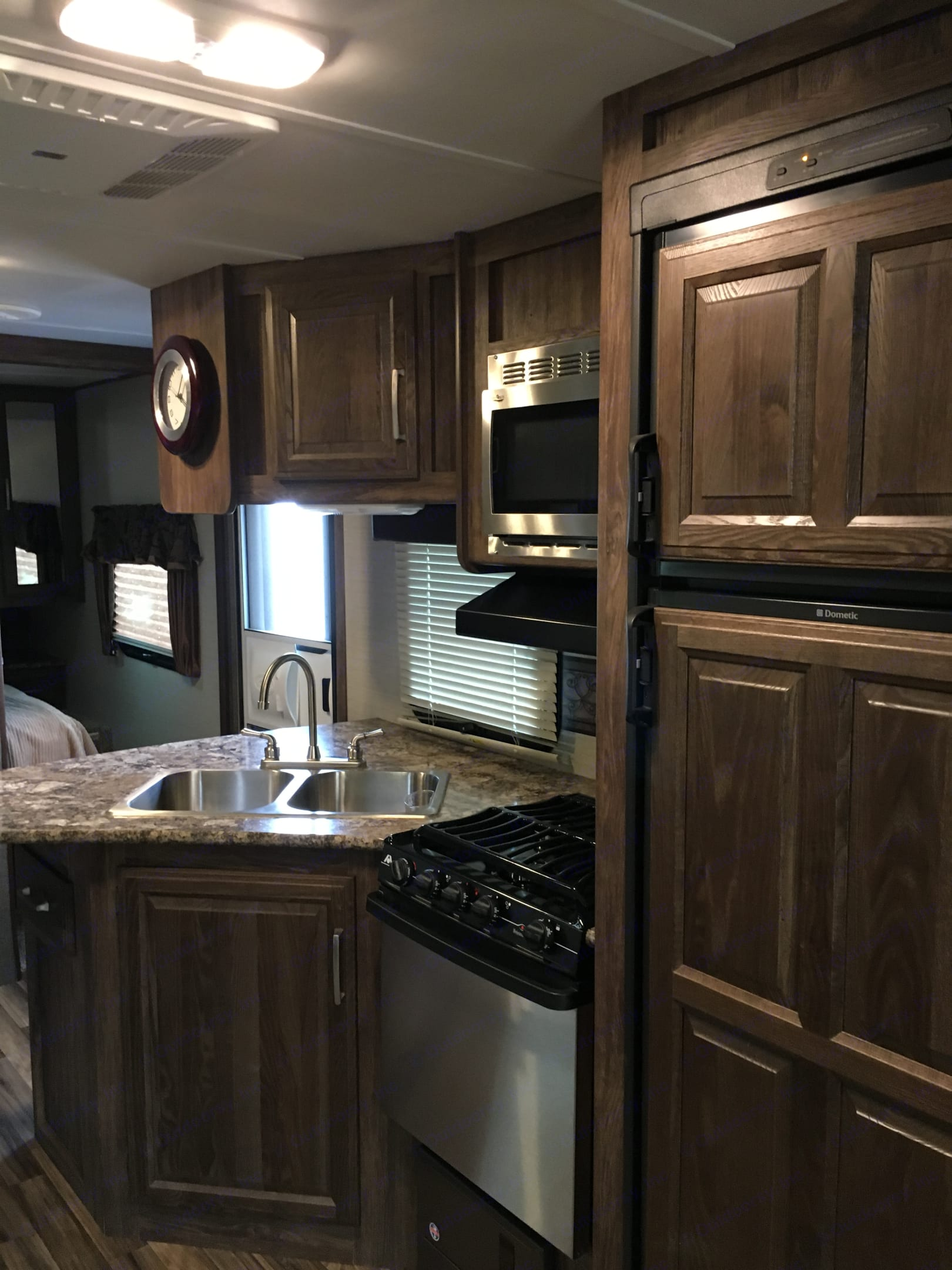 Kitchen, microwave, stove with oven.. Keystone Cougar 2016