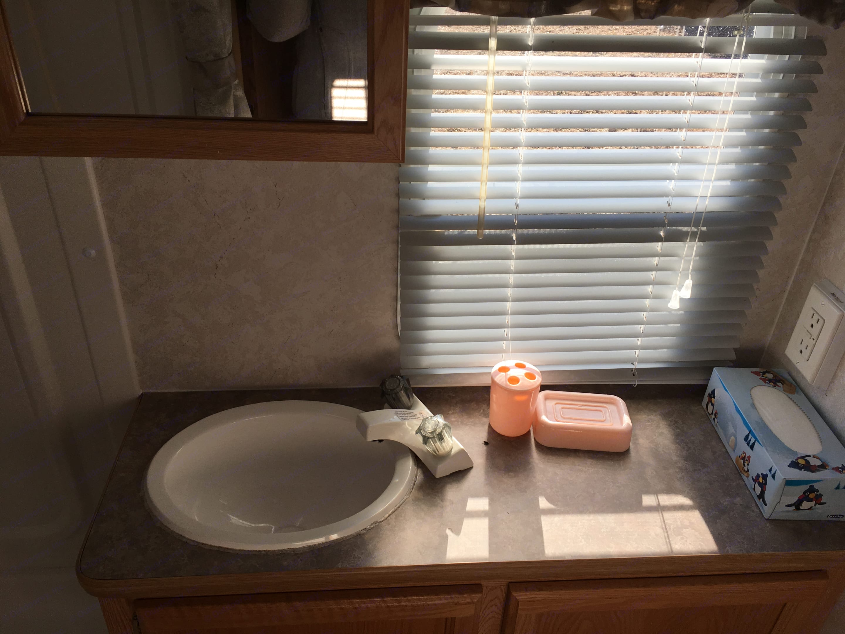 Cozy bathroom with a shower, sink and toilet. Lots of light from the window. . R-Vision Trail-Lite Trail Lite 2002