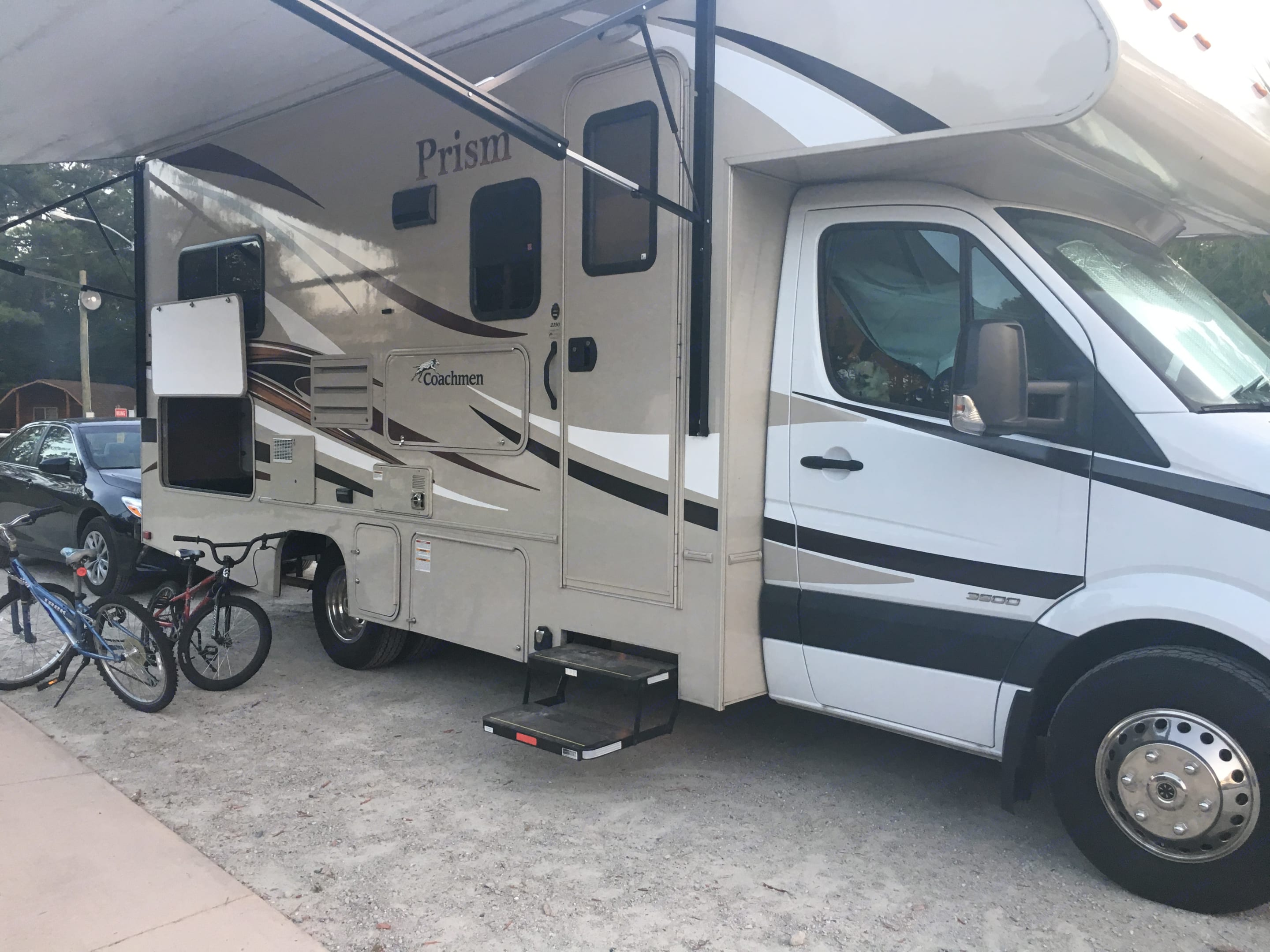 Awning, storage cabinets on exterior. Outside show on other side. . Coachmen Prism 2015