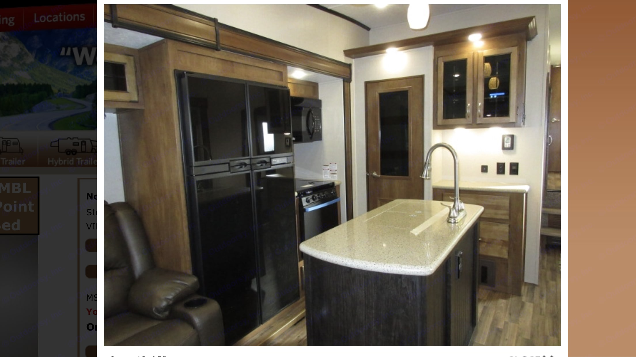 Kitchen w/ extra large fridge, pantry and full size microwave.  Solid surface counters, residential faucet, and deep stainless sink.. Coachmen Chaparral 2019