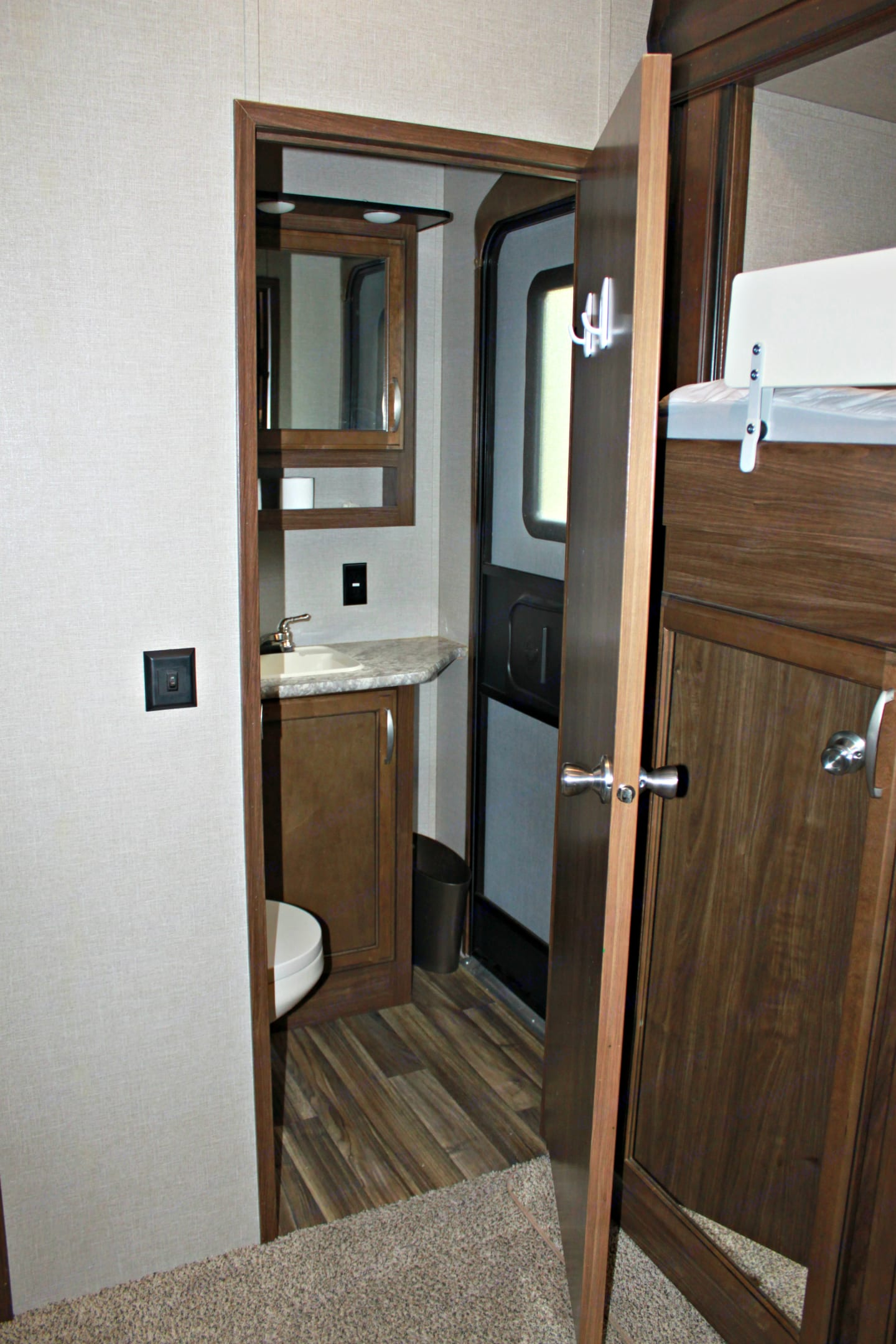 Bunk room 1/2 .bath with door to the outside for easy access. Keystone Montana High Country 2016