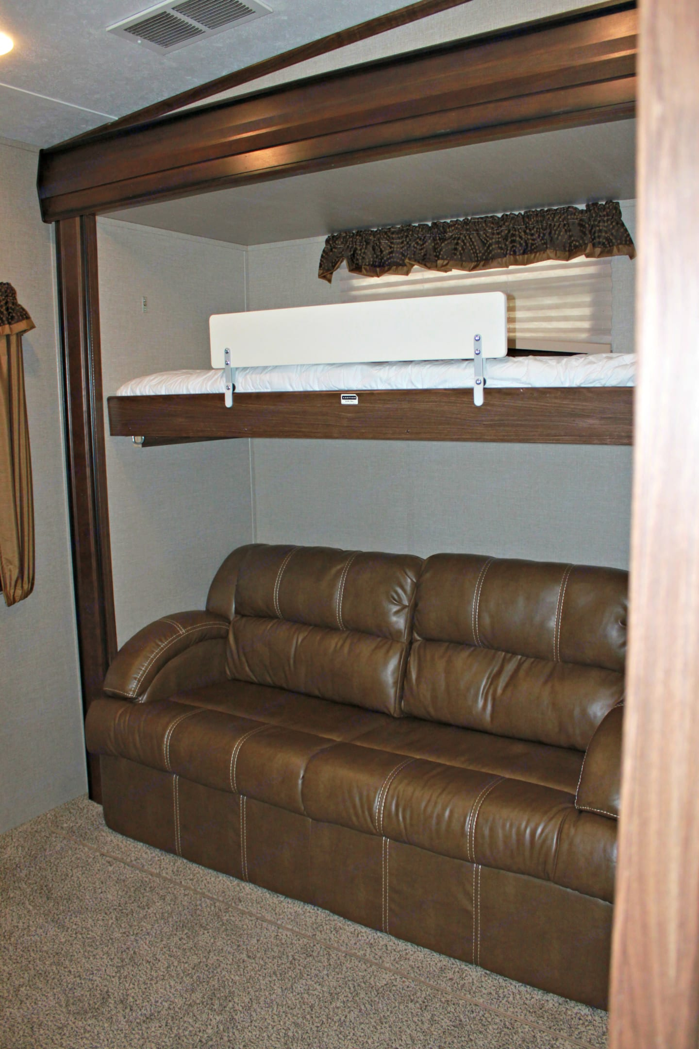 Right side on bunk room. Bed up top, full bed sofa bed pullout underneath.. Keystone Montana High Country 2016