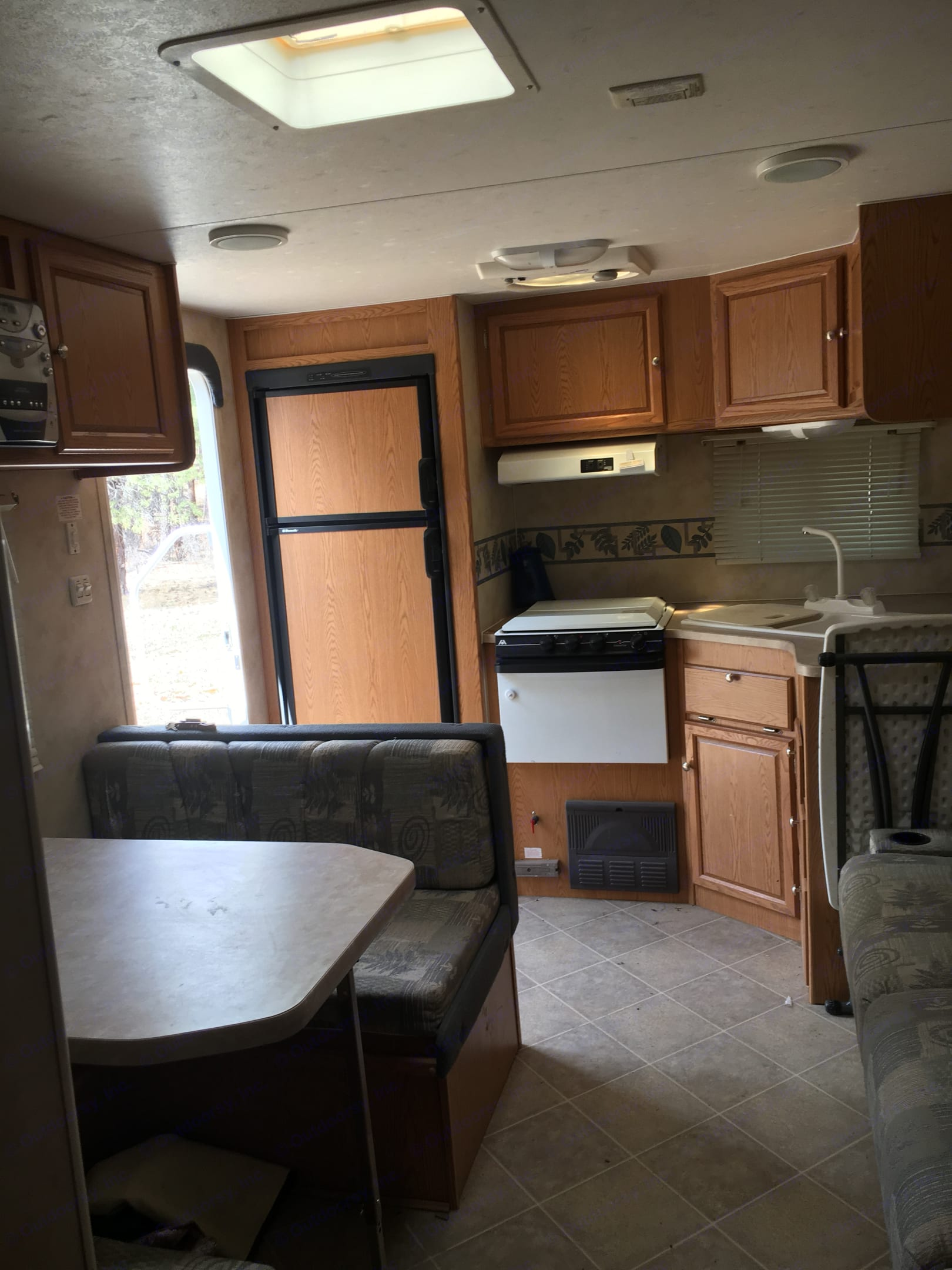 Kitchen and table.  Table flattens into bed for one adult or two small children. Refrigerator and freezer can run off propane or battery. Stove and oven! Lots of windows to let in light and enjoy mountain breezes.  Folding table in picture is there for your use.. Skyline Other 2006