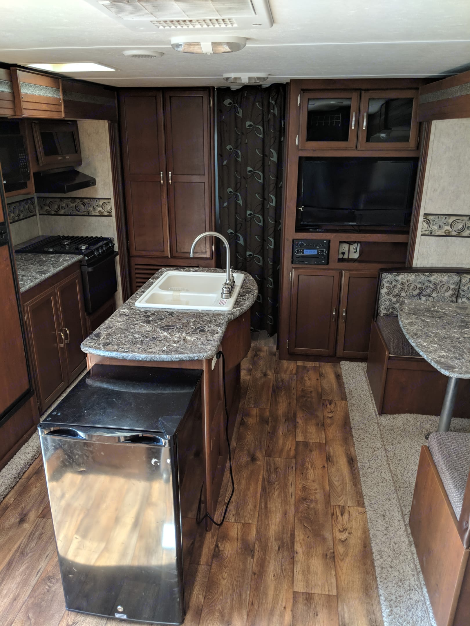 Kitchen island and extra refrigerator provides extra space to store and prepare family meals.. Keystone Passport 2014