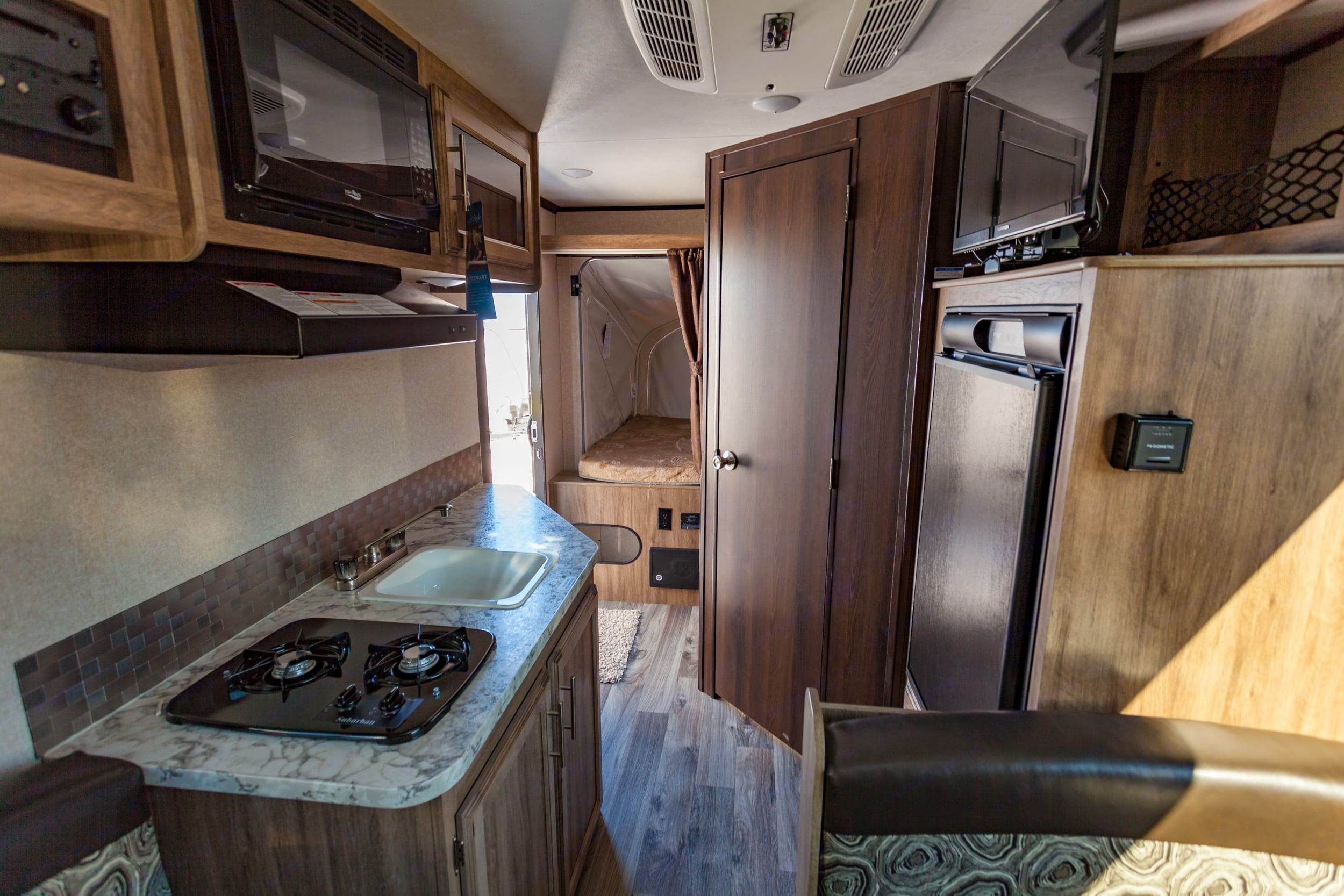 Kitchen, entry, bathroom on the right and one bed folded out in the back.. Jayco Jay Feather Ultra Lite 2017
