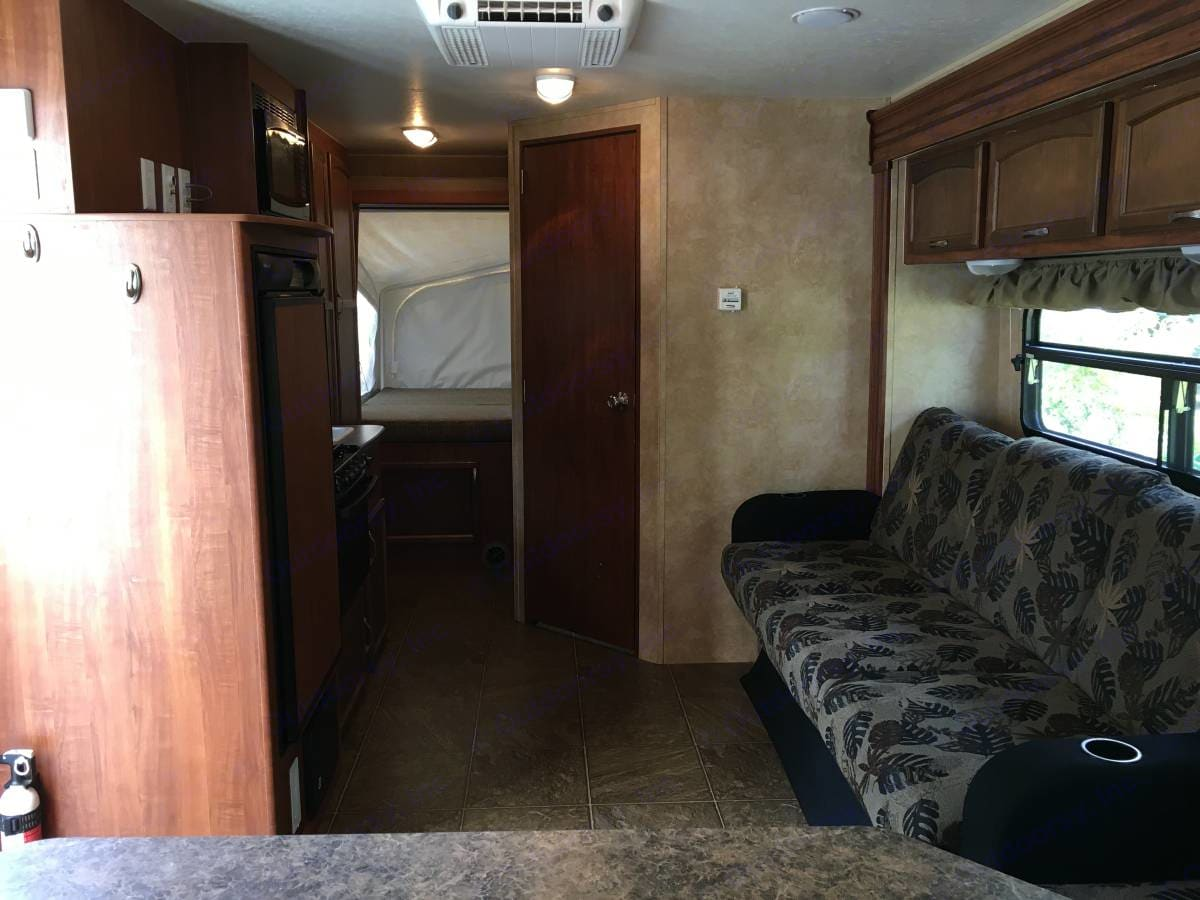 Full bed in rear with jackknife couch. Jayco Jay Feather 2011