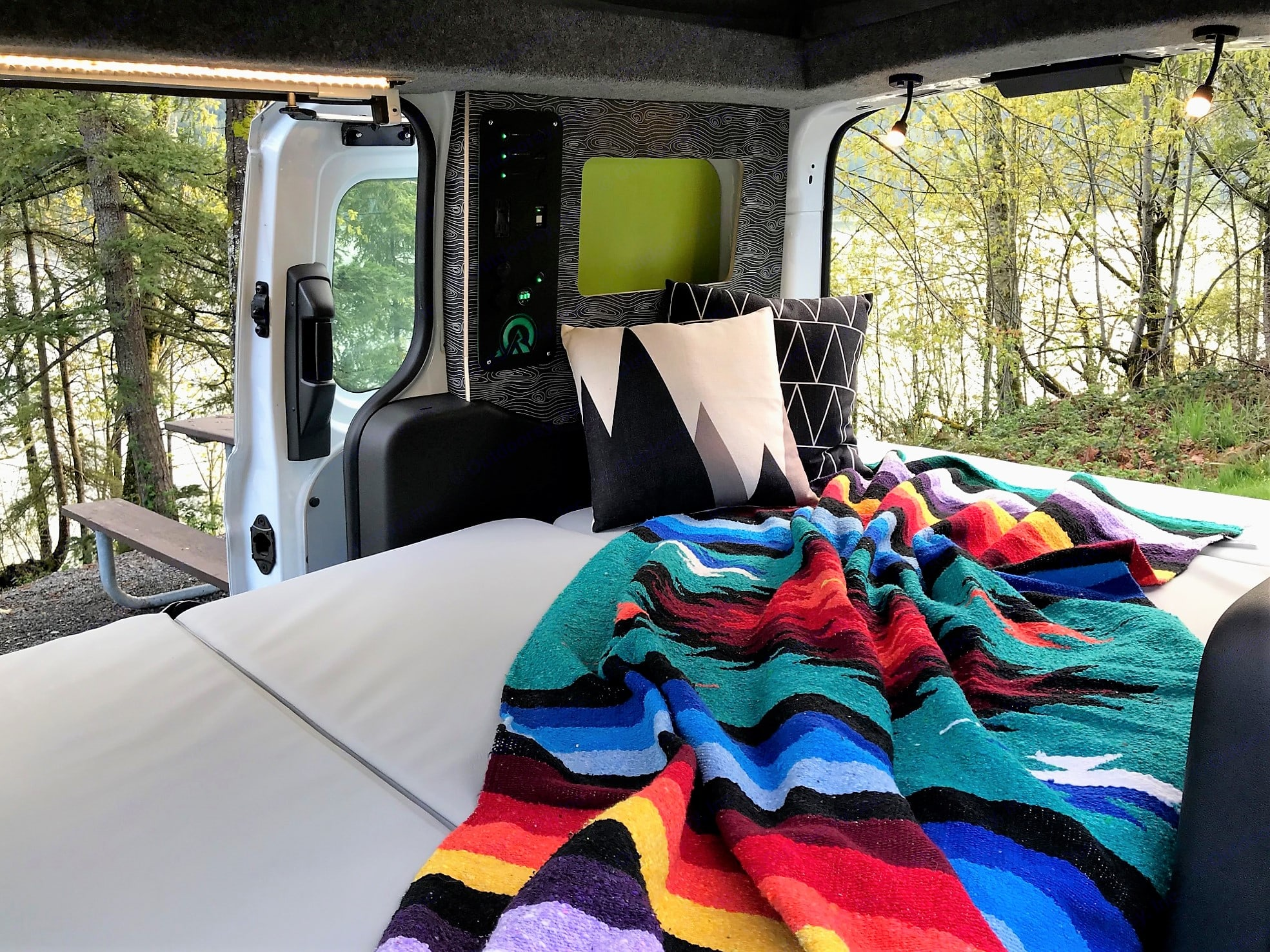 Pull out the bench to convert it into a 4' x 6.5' (1.2m x 2m)  bed that comfortably sleeps 2 adults, even the taller ones.. Ford Transit Connect 2016