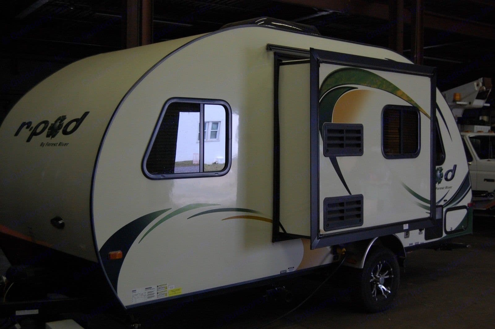 Electric slide out is simple & gives more living space.  The trailer is also completely usable without the slide open.. Forest River R-Pod M178 2014