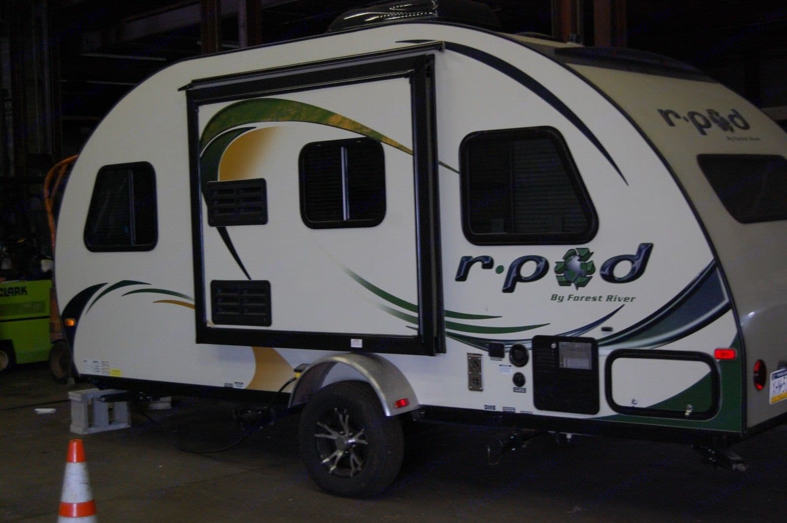 Electric slide-out is easy to use, and increases space inside.  The trailer is also very usable with the slide-out closed.. Forest River R-Pod M178 2014