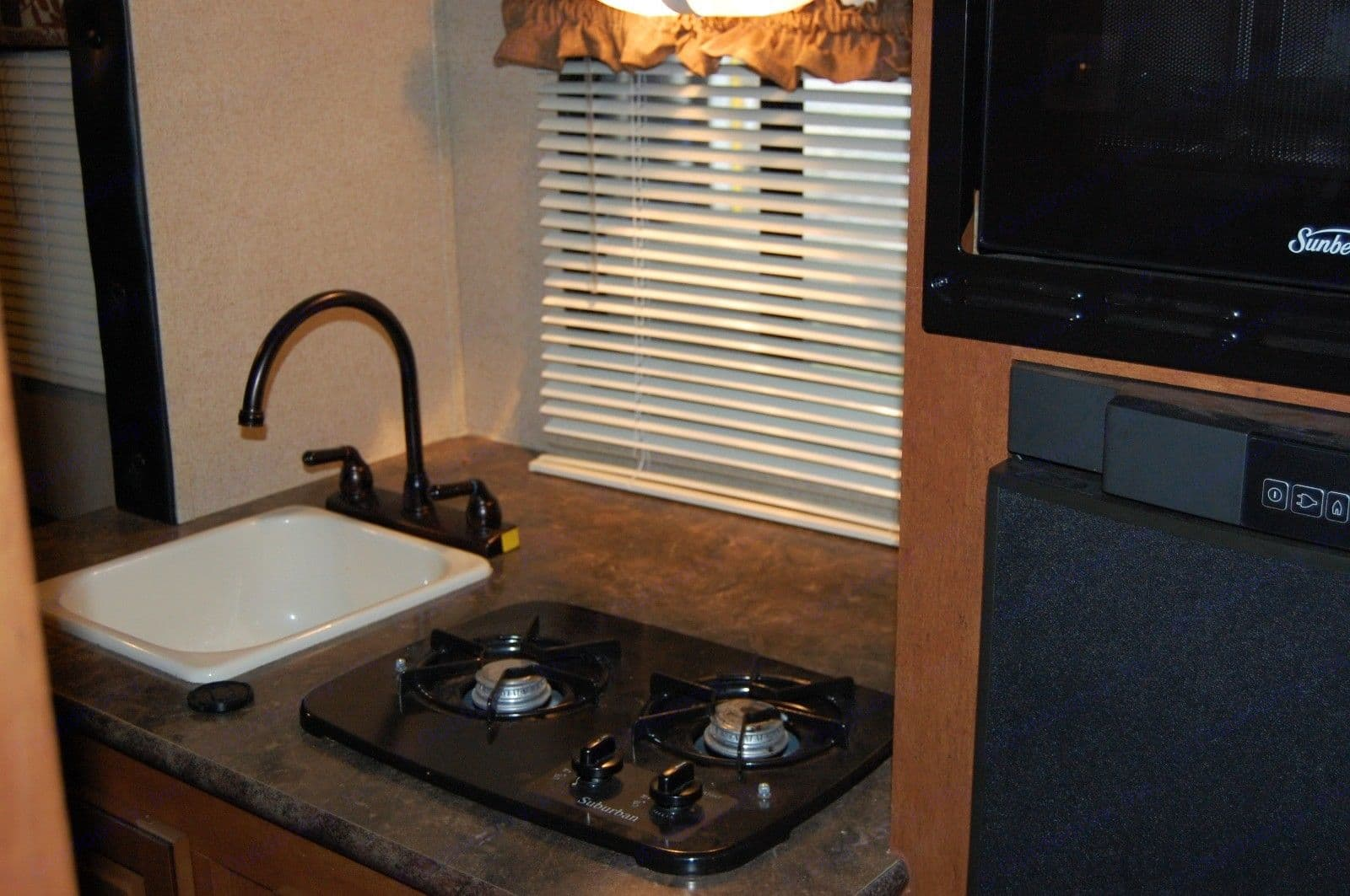 The unit has a combination microwave/convection oven.. Forest River R-Pod M178 2014