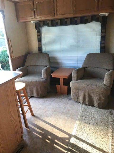 L shaped living area.  Large window behind the chairs.. Pilgrim International Pilgrim 2005