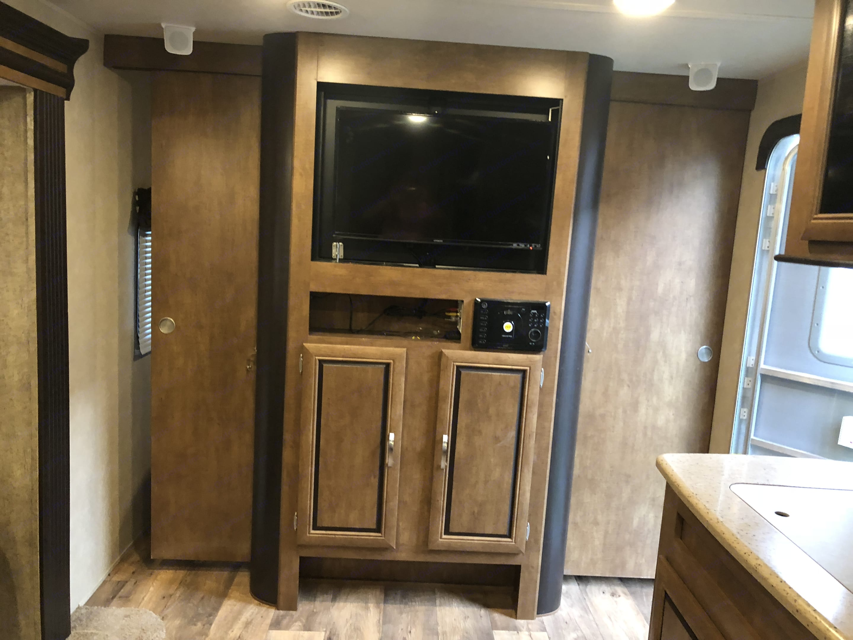 TV that also turns around into the bedroom and doors close on the side for privacy.. Forest River Salem 2017