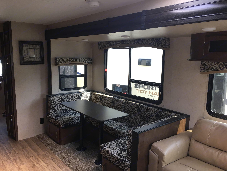 Kitchen seating, converts to sleeping area. Venture Rv Sporttrek 2018