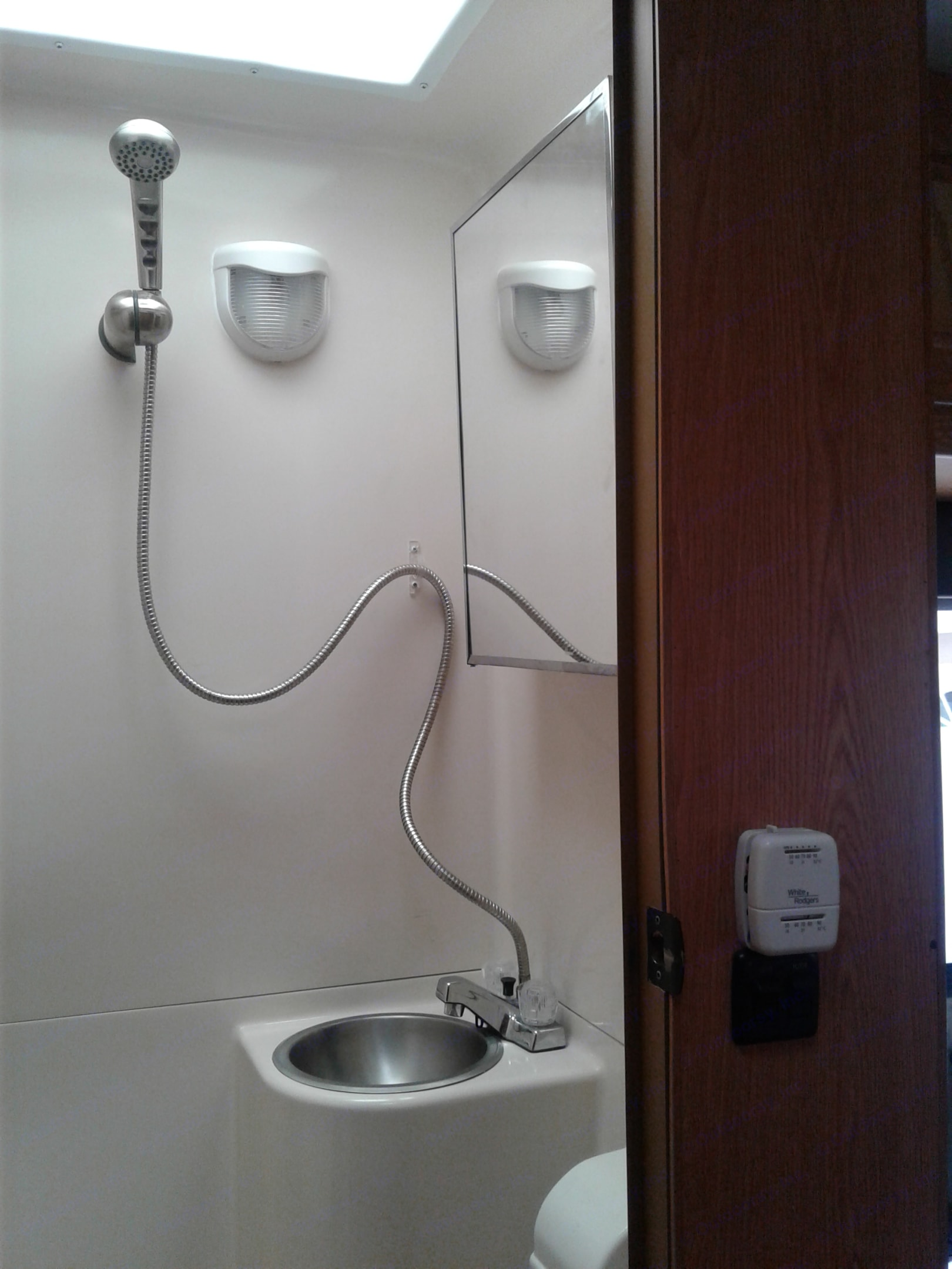 Bathroom with shower, sink and toilet.. Thor Motor Coach Four Winds Majestic 2010