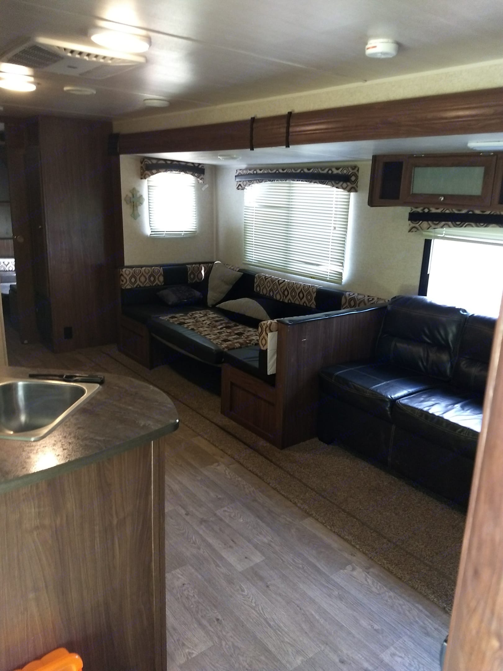 Living room slide out has two chairs and a storage underneath that makes out into a bed the table also makes into a bed. prowler Lynx lx30 2018