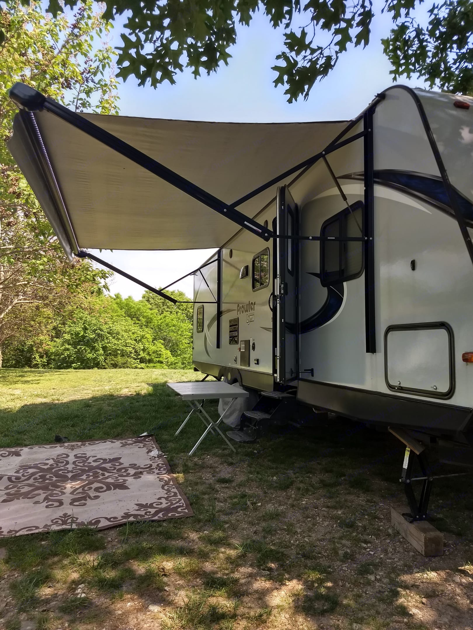 Owning comes out tilts also has LED lighting also a little small table that goes outside the door for camping. prowler Lynx lx30 2018
