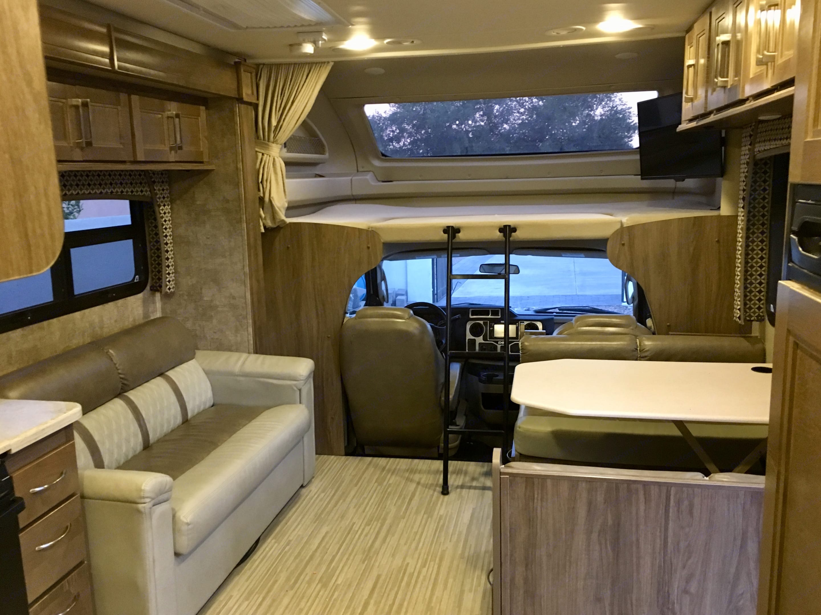 Queen over can bed with full window. Jayco Envoy 2018