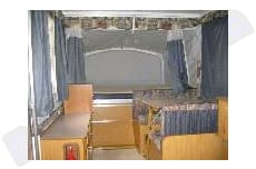 1 Queen, 1 Full bed and fold down dining table for another bed. Fleetwood Other 2004