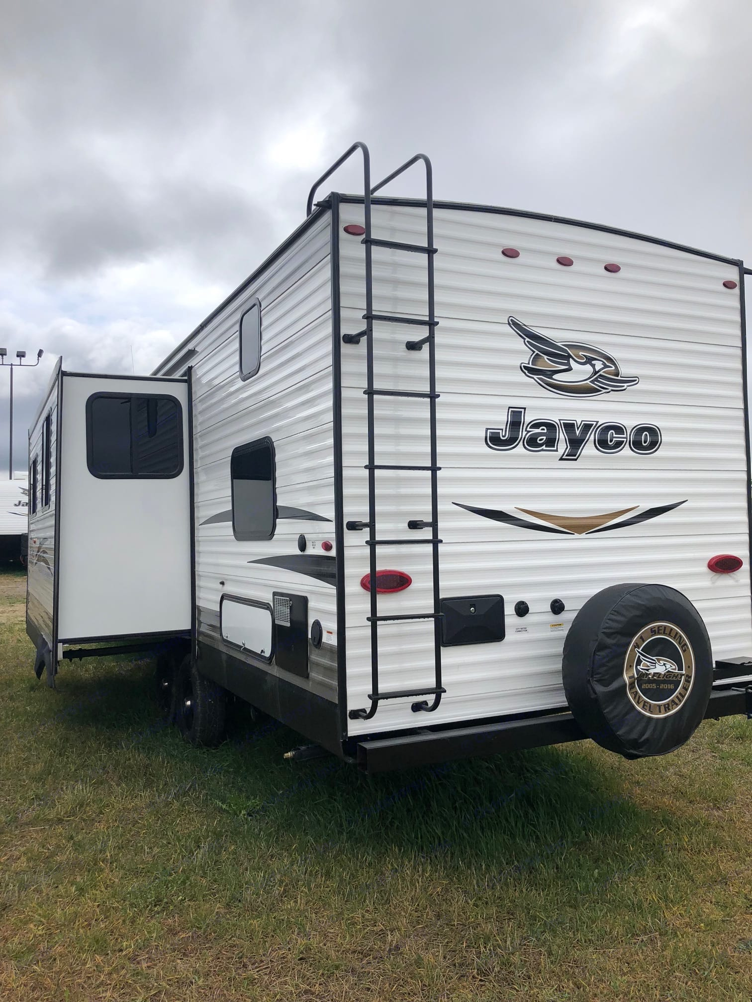 Outdoor shower located at the back of the trailer.. Jayco Baja 2018