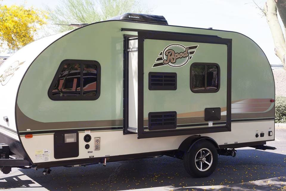 Exterior of trailer showing the pop-out. With the pop-out fully open, the trailer is still able to fit into almost any camping space! . Forest River R-Pod 2016