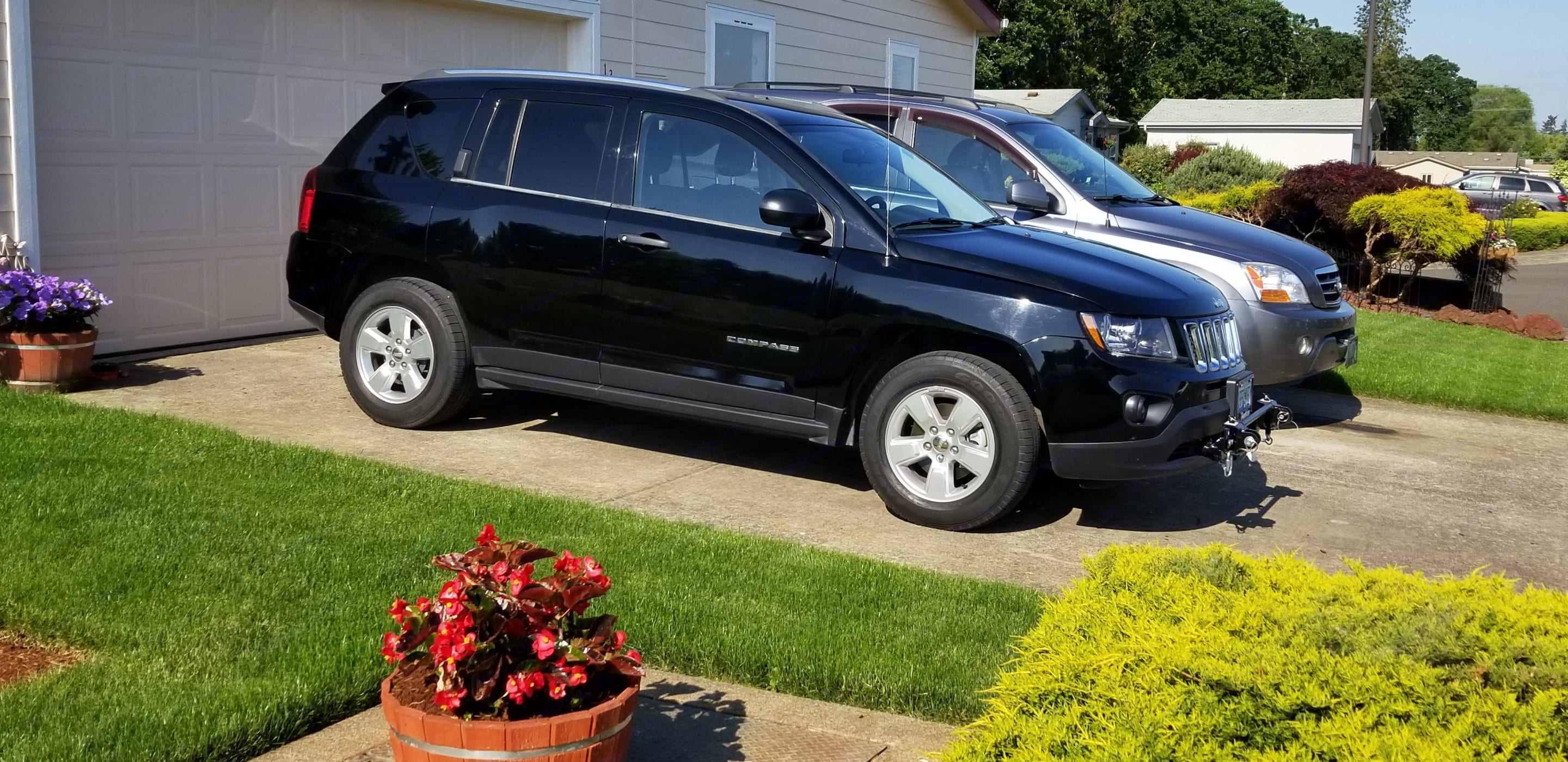 2014 Jeep Compass (manual transmission) setup to pull behind our 2008 Class A Itasca Sunover 30' RV. Jeep Compass 2014