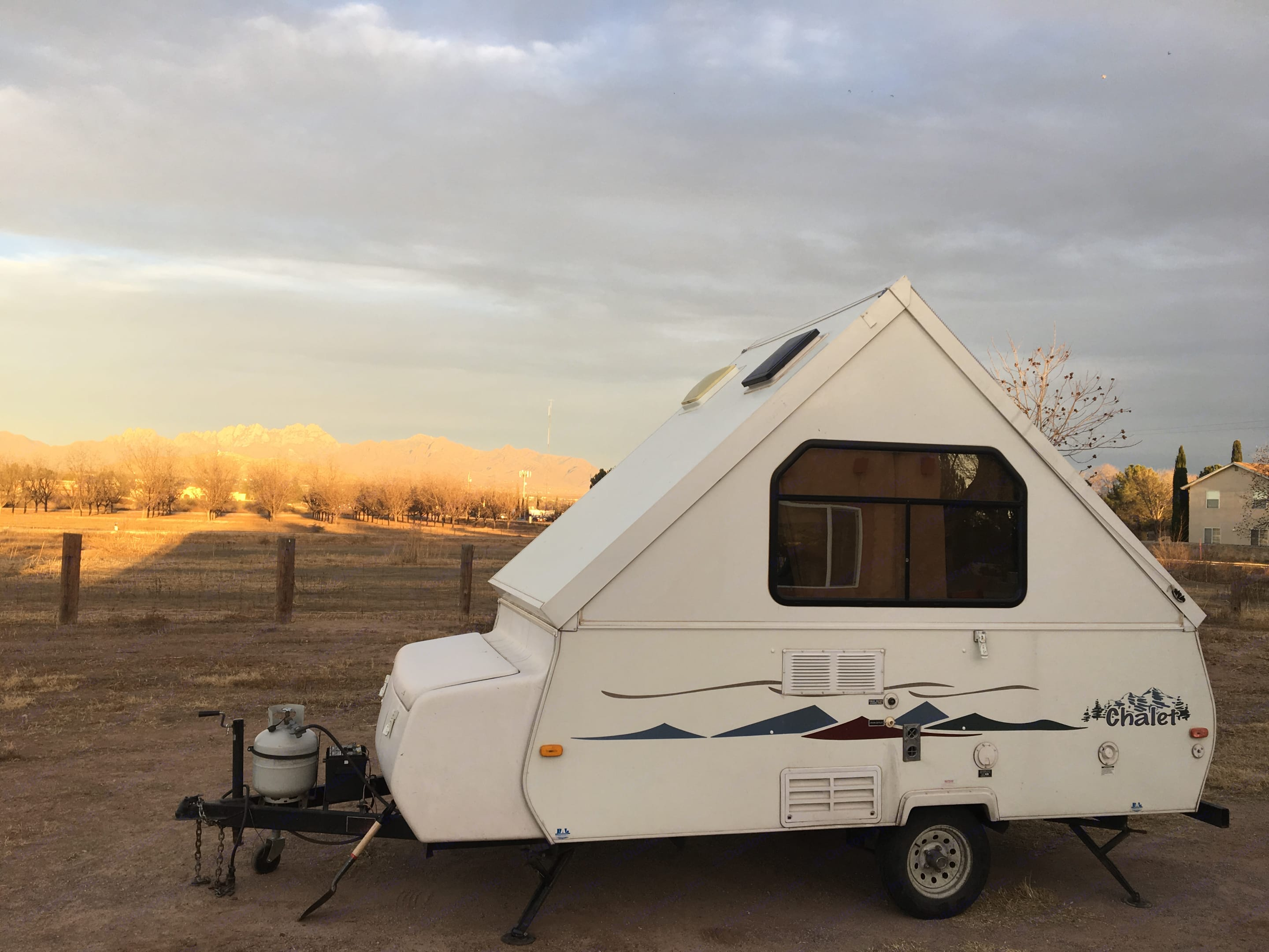 Here she is all set up in Las Cruces at sunset. ChaletRv A-Frame 2005