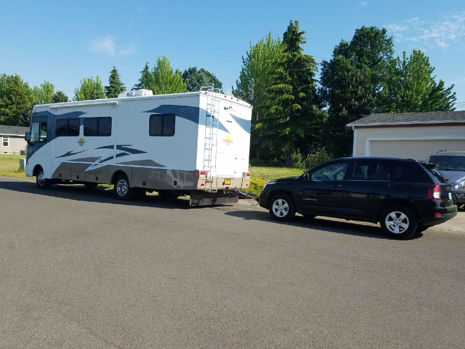 2014 Jeep Compass (manual transmission) pulled behind our 2008 Itasca Sunover 30' Class A RV.. Jeep Compass 2014