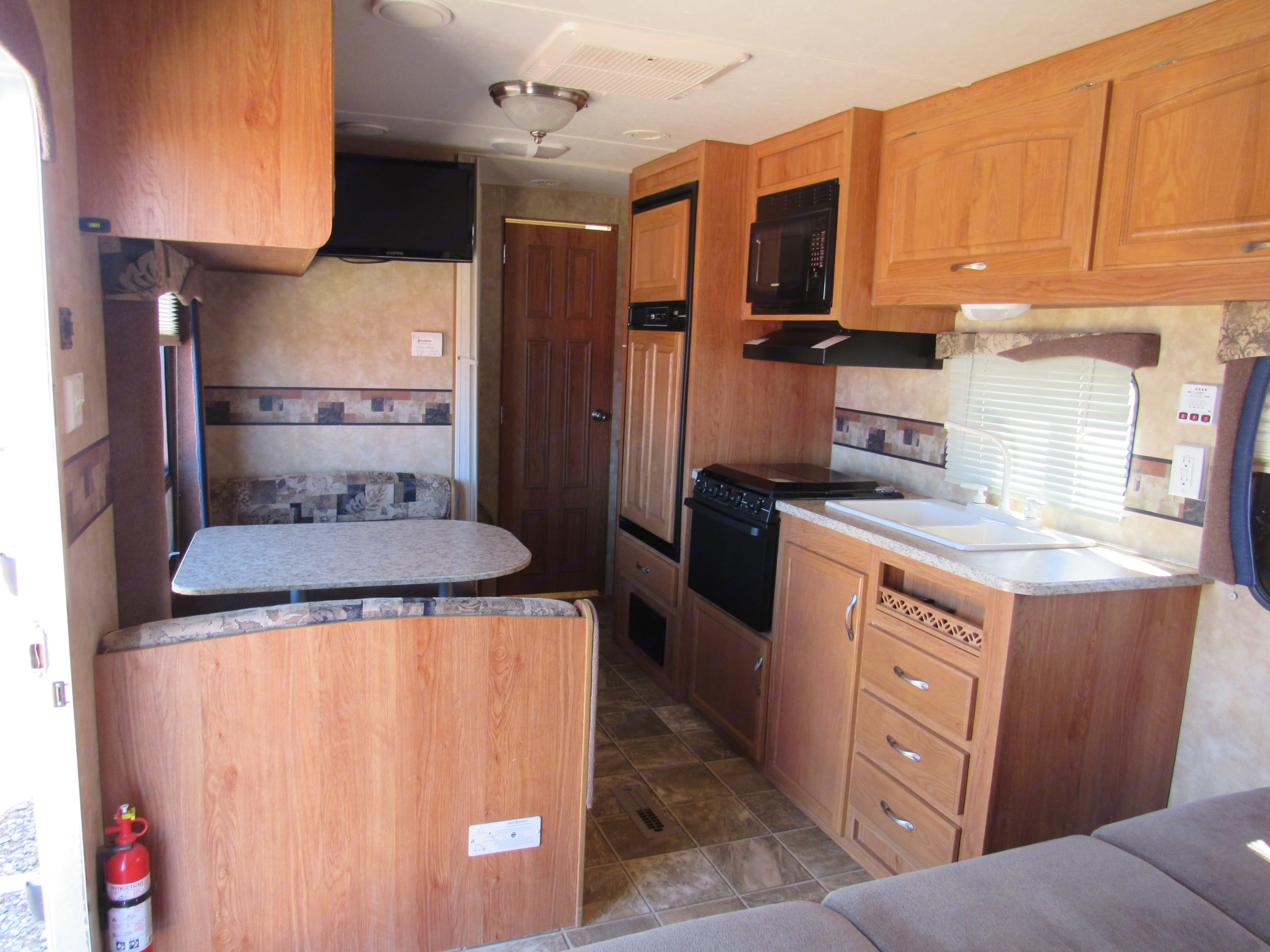 The table makes down into a bed.  A stove or a microwave for your cooking needs.  You must be plugged into power for the microwave to work.. Jayco Jay Flight 2009
