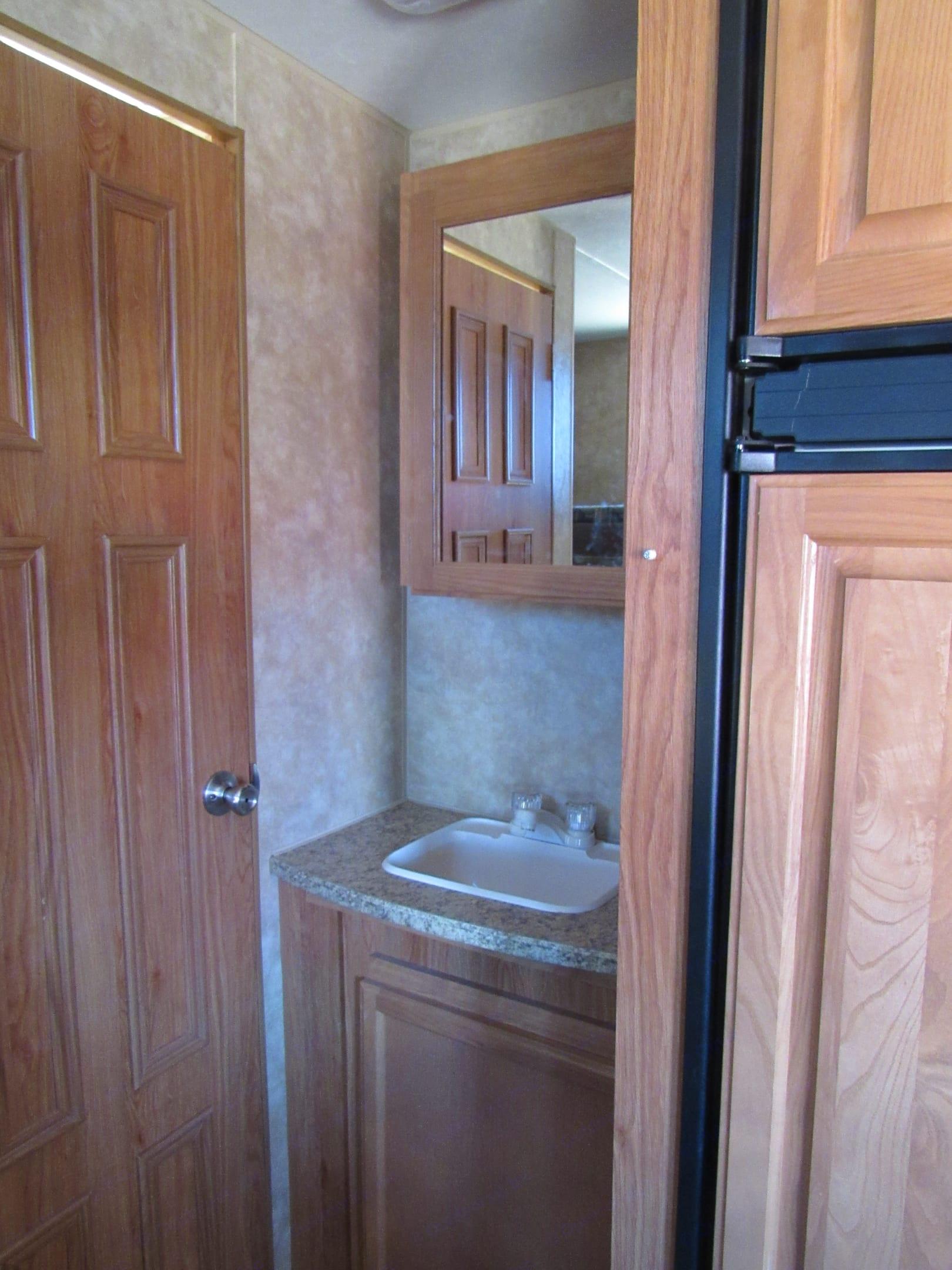 Bathroom sink is outside the bathroom for maximum flexibility.. Jayco Jay Flight 2009