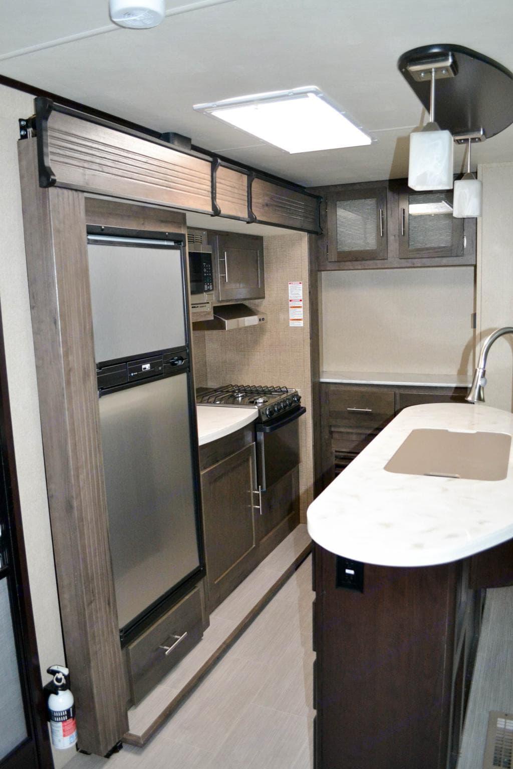 Kitchen with island .. Dutchmen Kodiak 2017