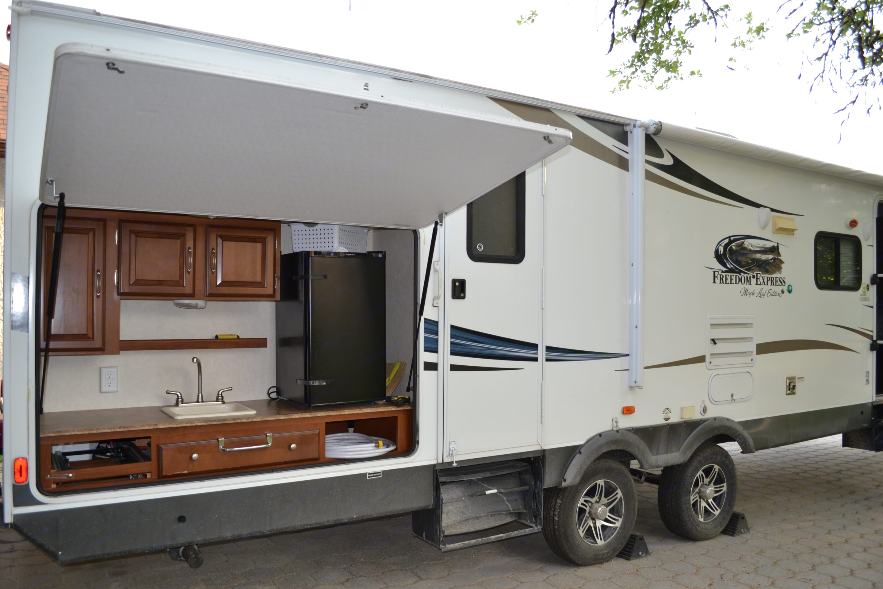 Outdoor Kitchen with sink & 2nd fridge - very handy to keep the fun going on outside as opposed to having to run inside!. Coachmen Freedom Express 2013