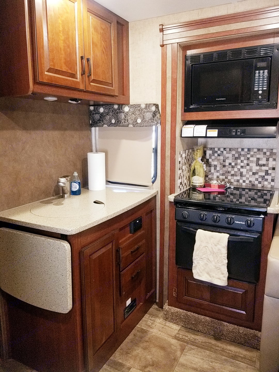 Kitchen has fold out counter space and a sink cover, when you are working on a larger meal.. Forrest River Forrester 2017
