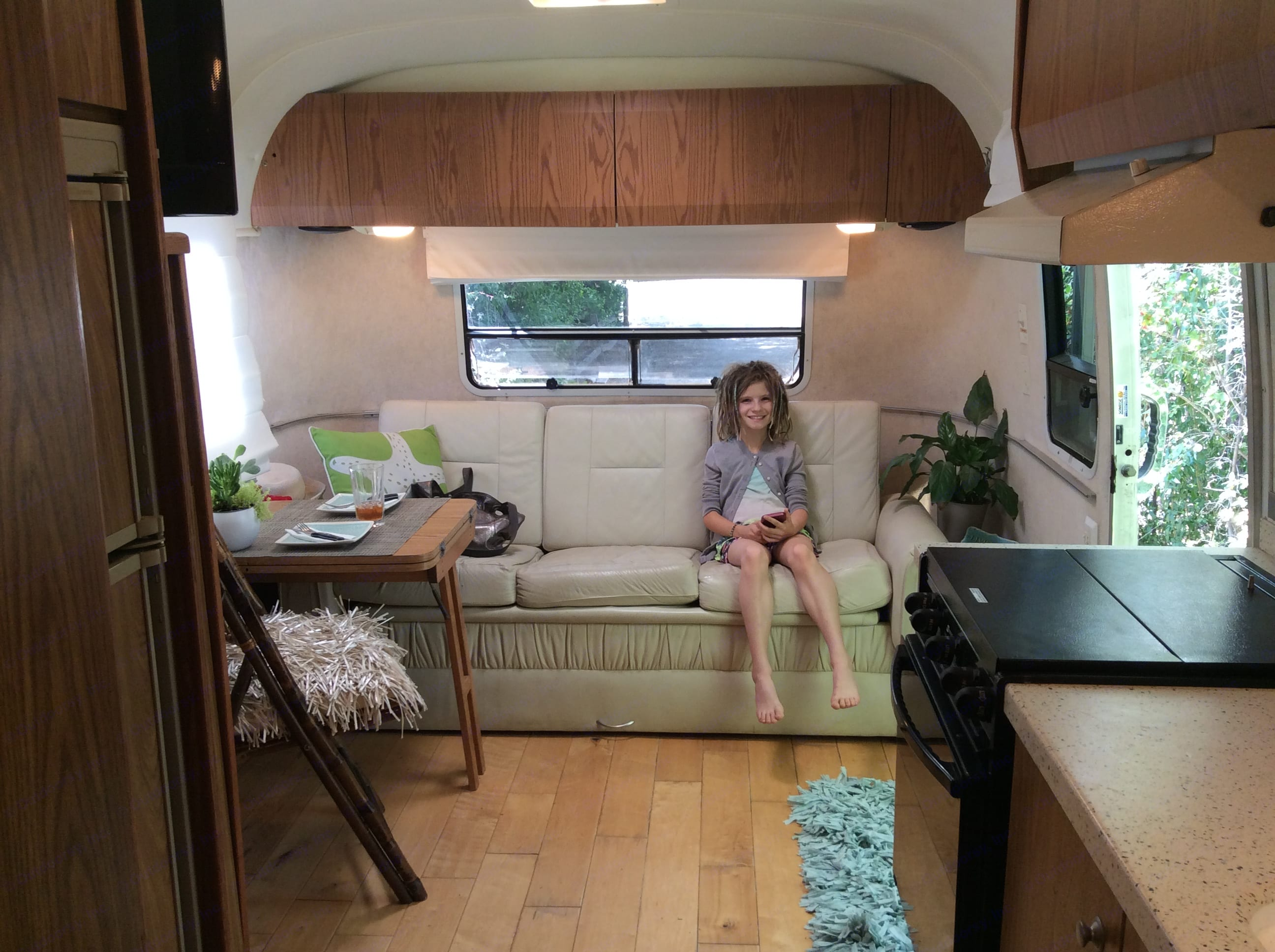 Living area with kitchenette and converting couch / bed.. Airstream Safari 1999