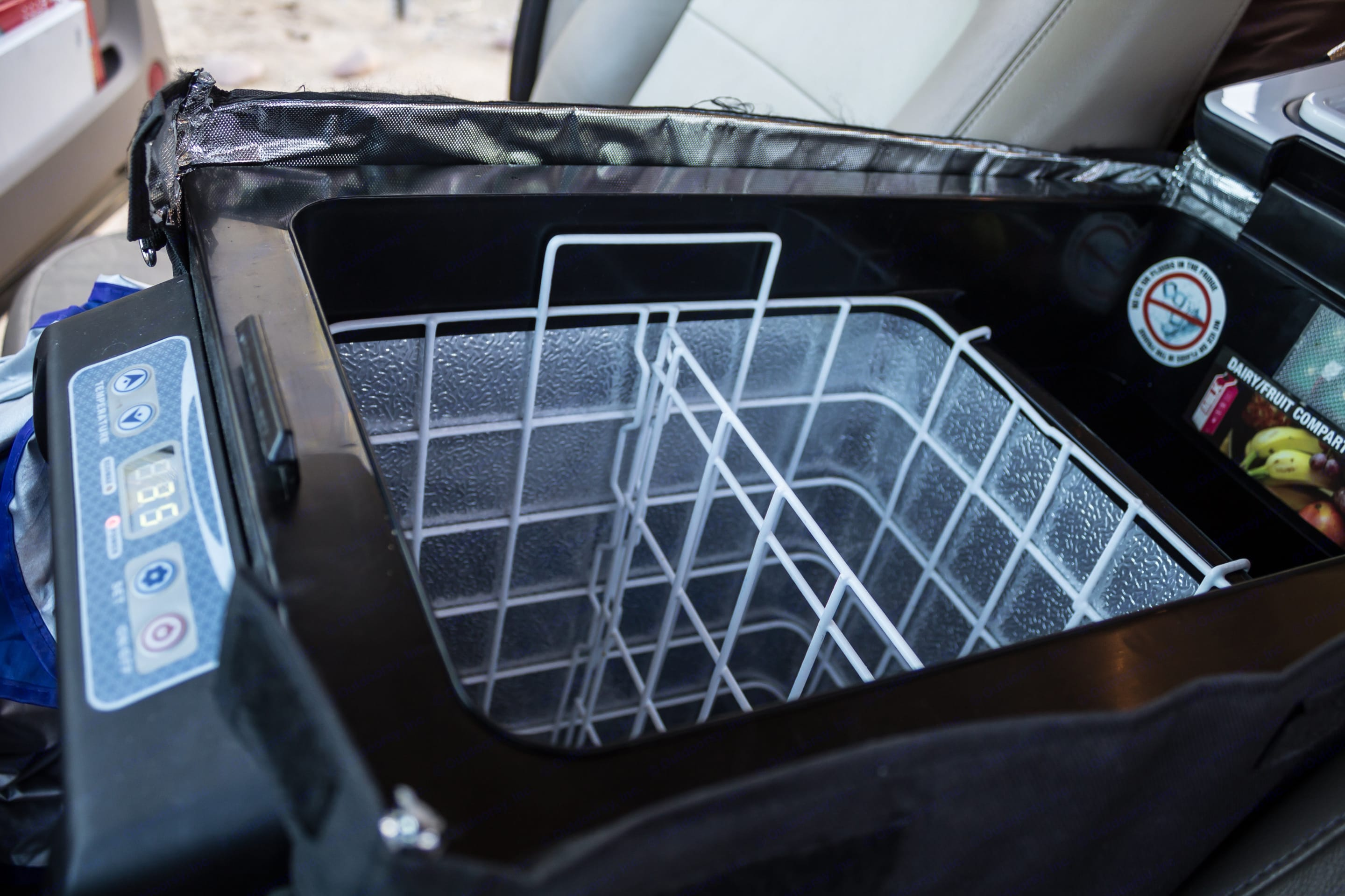 The 12-volt fridge has an aux battery that it's powered by, and is nice and deep with a removable divider, so you can fit all sorts of items...tall and small.. Ford Expedition Camper Van Camper Van Adventure Rig 2005