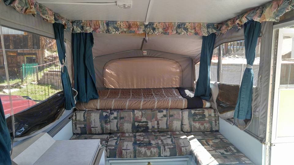 Full Bed (Sleeps 2) - Complete with clean pillows, bedding, blankets, and comforter.  U-Shaped seating area in front of Full Bed converts into Full Bed (Sleeps 2) - Also complete with clean pillows, bedding, and blankets.. Jayco 1207 1996