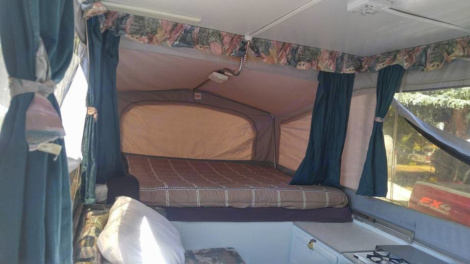 Queen Bed (Sleeps 2) - Complete with clean pillows, bedding, blankets, and comforter.  Dinette/Couch Seating area converts into Twin Bed (Sleeps 1) - Also complete with clean pillows, bedding, and blankets.. Jayco 1207 1996