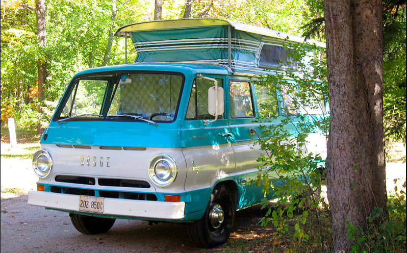 With the poptop up and the curtains drawn, the CampWagon makes for a nice home at the campsite. It is best to put the top down when there is rain or high winds. Jo. Dodge CampWagon 1967