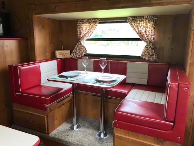 U shaped Dinette in slide out with large picture window and under seat storage- converts to bed  . Gulf Stream Cruiser 2018