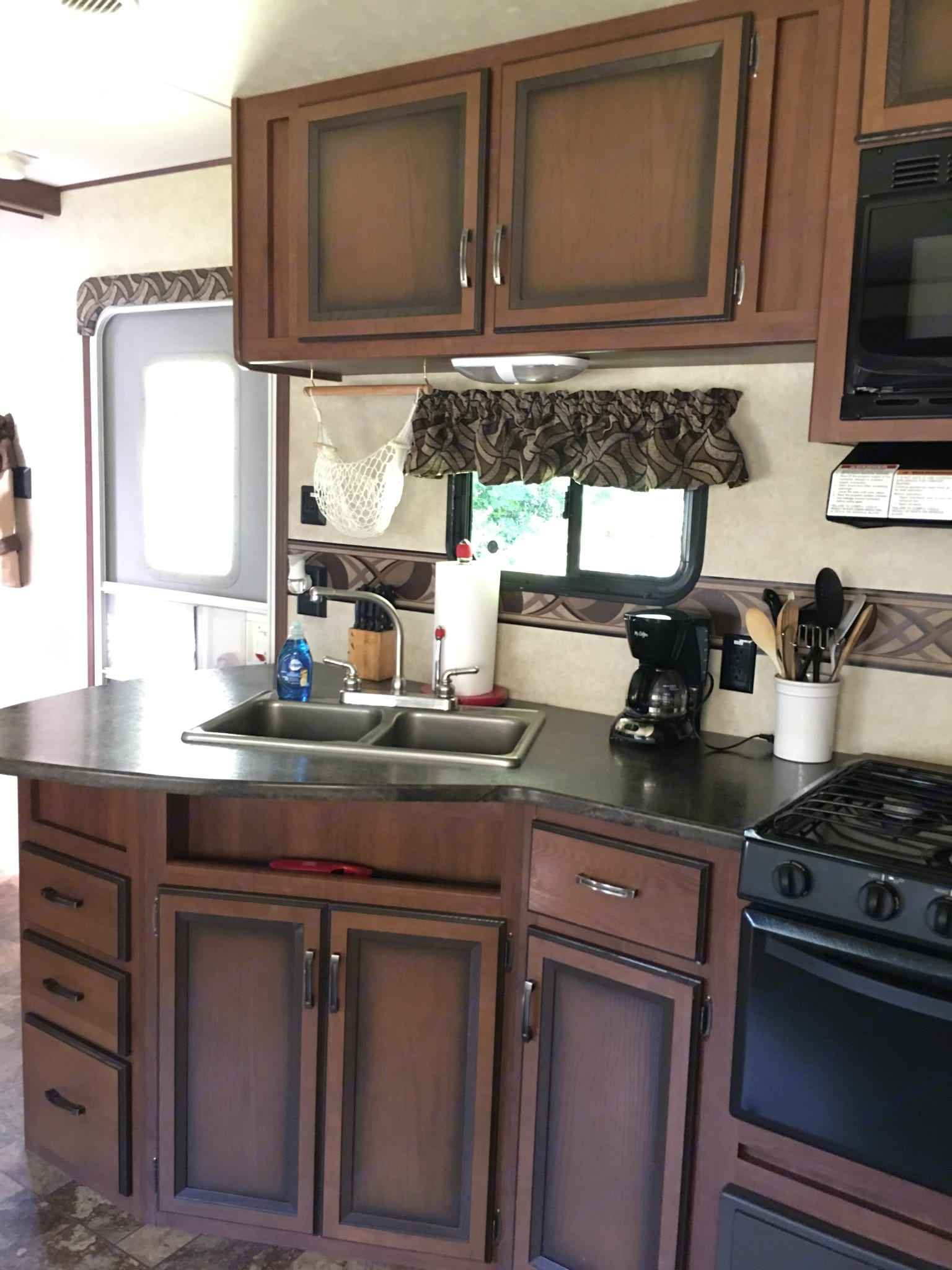 Kitchen including coffee pot, dishes, knives, paper towels, etc. . Thor Motor Coach zinger 2013