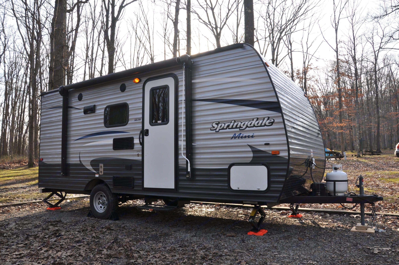 Typical camping setup at a full hookup location.. Keystone Springdale 2018