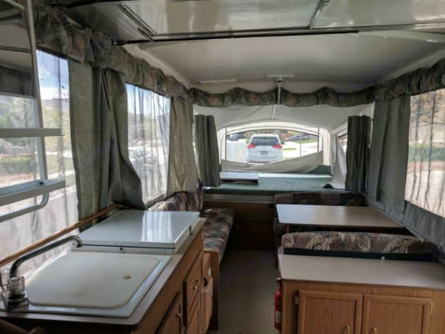 Bench & Dinette fold down into beds. Coleman Westlake 2000