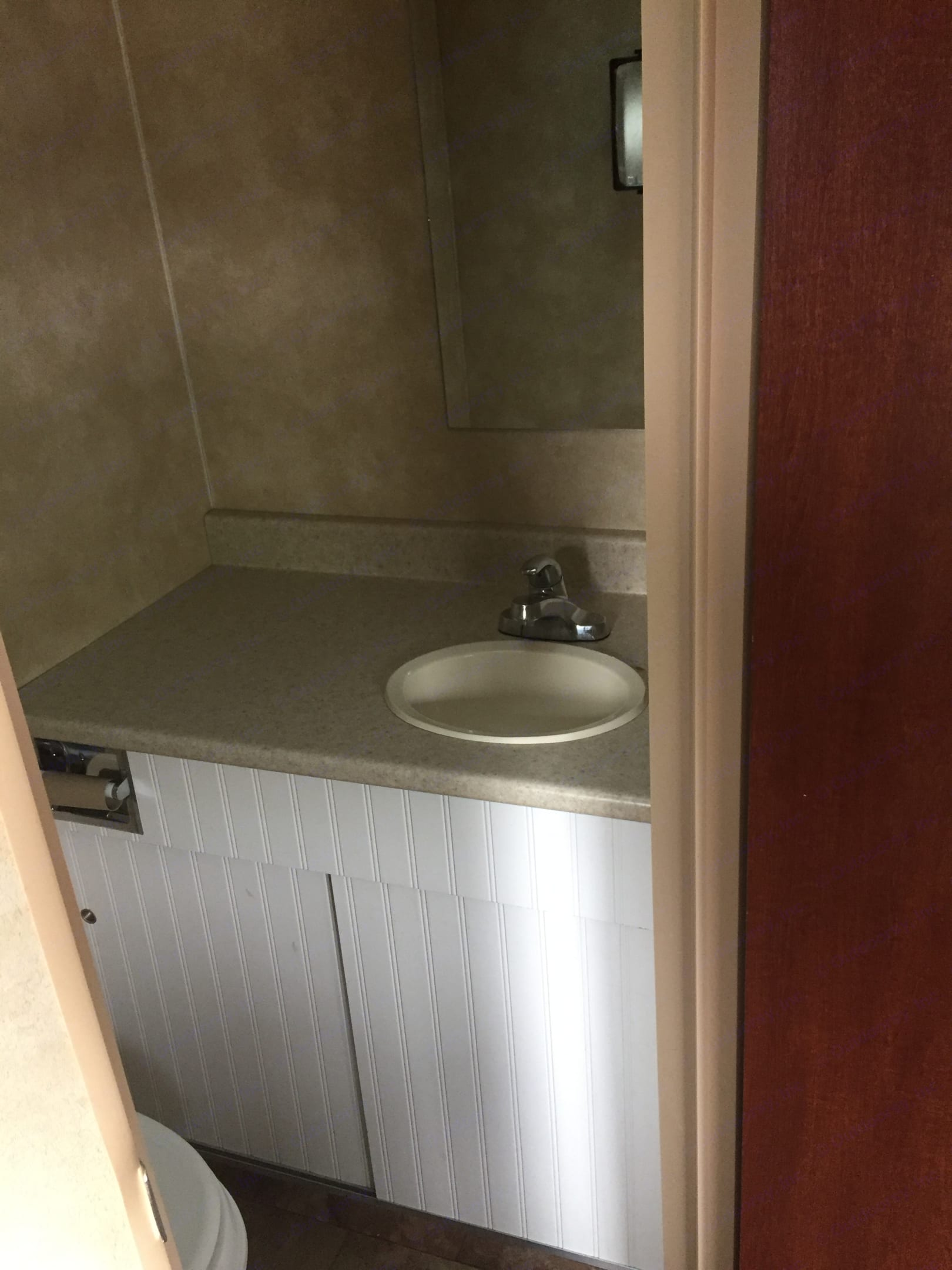 there is no shower as the previous owner built in a small vanity and sink . Coachmen Viking 2013